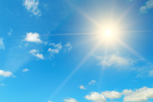 Blue Sky. Bright Midday Sun Illuminates The Space.