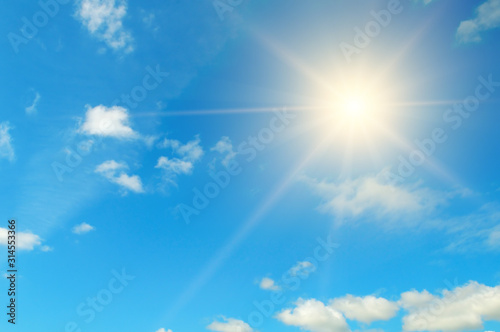Obraz Blue sky. Bright midday sun illuminates the space. - fototapety do salonu