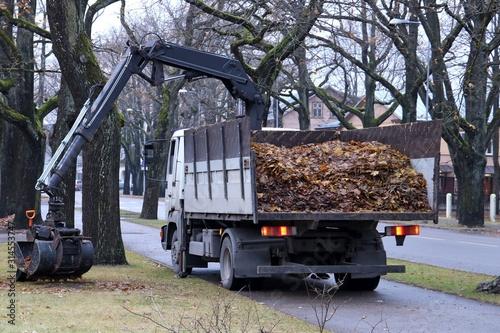 Vászonkép Dump Truck with Crane. Clamshell telescopic arm