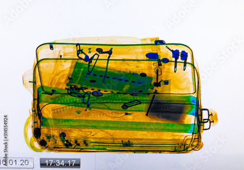 Photo Scanned baggage on the x-ray scanner screen at the airport