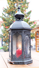 Christmas Lantern With A Candle In The City Square