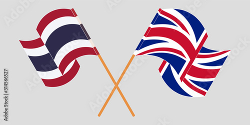 Crossed and waving flags of Thailand and the UK Canvas Print