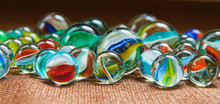 Group Of Marbles On A Textured...