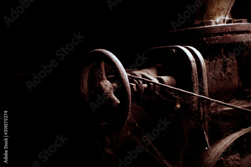 old large rusty valve on main pipeline with cobweb on it Canvas Print