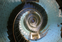 Looking Down The Spiral Staircase Inside The Eckmuhl Lighthouse In Brittany, France