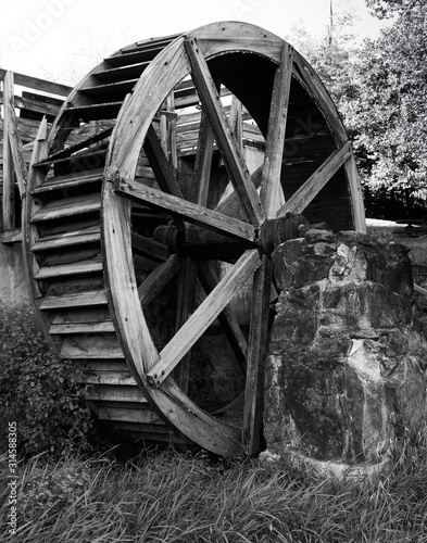 Photo Waterwheel on roller mill (gristmill) state historic site along the banks of the