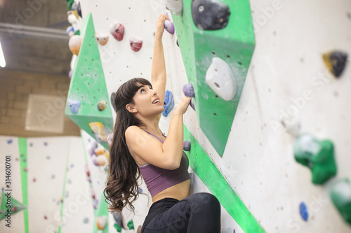 Girl doing bouldering in a climbing centre Canvas Print