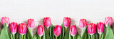 Fototapeta Tulips - Beautiful pink tulips on wooden background.