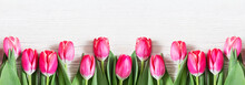 Beautiful Pink Tulips On Woode...