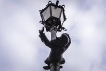 Small Dwarf Statue On A Lanter...