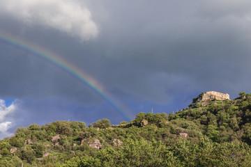 Rainbow over hill with castle ruins of Castiglione di Sicilia town on Sicily Island in Italy