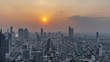 4K Day to Night timelapse of Sunset scence of modern office buildings and condominium in Bangkok city downtown with sunset sky and clouds at Bangkok , Thailand.