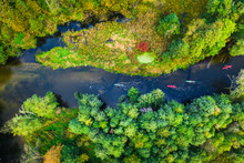 Kayaking On River Near Autumn Forest, View From Above