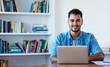 Leinwanddruck Bild - Handsome mexican hipster man working with computer