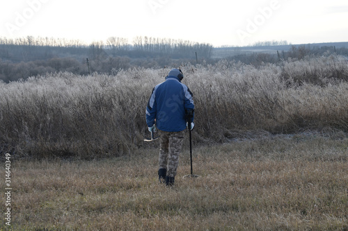 Digger with metal detector in the field Canvas Print
