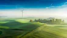 Foggy Wind Turbine At Sunrise, View From Above