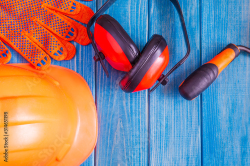 Orange hard hat and tool on wooden vintage blue boards Wallpaper Mural