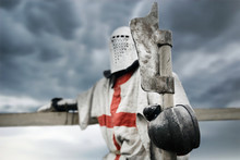 Crusader In Armor Holding Axe.