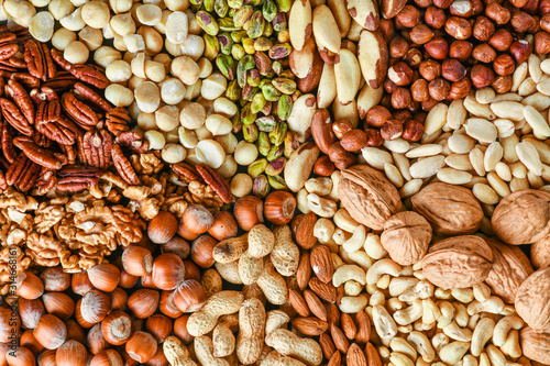 Natural healthy background made from different kinds of mix nuts like walnuts, hazelnut, pistachio, almond, cashew, pecans.