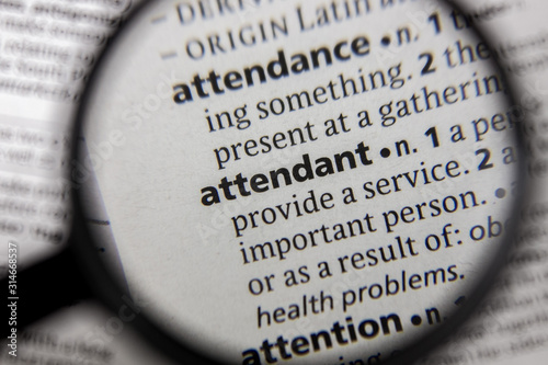 Photo The word or phrase attendant in a dictionary.