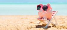 Pink Piggybank On Deck Chair O...