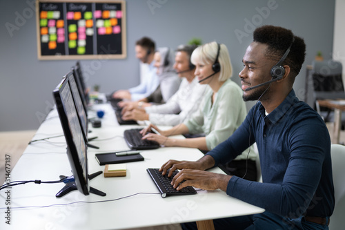 Fotografiet Male Customer Services Agent In Call Center