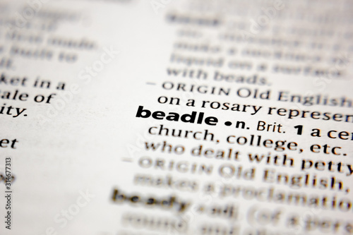 Photo Word or phrase beadle in a dictionary.