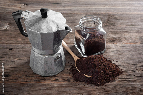 Платно still life photography : ground coffee on old wooden table with old Italian styl