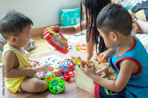 Group of baby friend playing toy together in living home