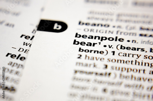 Photo Word or phrase beanpole in a dictionary.