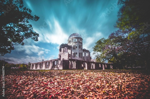 Stampa su Tela Low angle shot of the famous Atomic Bomb Dome in Hiroshima, Japan during autumn