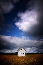 Vertical Shot Of A White Cabin...