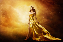 Woman In Gold Dress Looking To Space Stars, Beautiful Fashion Model On Golden Night Sky