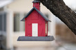 red birdhouse is hanging from your tree