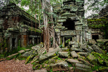 Temples Of Angkor Wat  Where The Jungle Has Partially Overgrown The Ruins Near The City Of Siem Reap In Cambodia