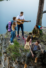 A Group Of Young Tourists Havi...