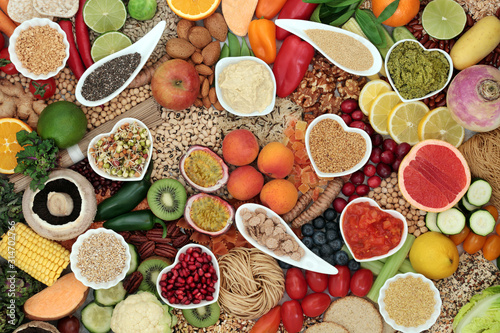 Fototapeta Healthy vegan super food diet with fruit, vegetables, nuts, spice, pasta, dips, spice & grains. High in protein, vitamins, minerals, antioxidants, dietary fibre & smart carbs. Ethical eating concept.  obraz