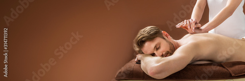 Young Man Receiving Back Massage At Spa Canvas Print