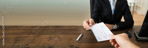 Carta da parati Businessman Giving Cheque To Other Person