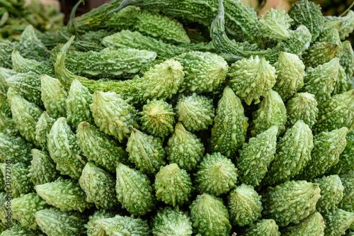 Karela vegetables or bitter gourd or bitter melon on market in Mumbai Canvas Print