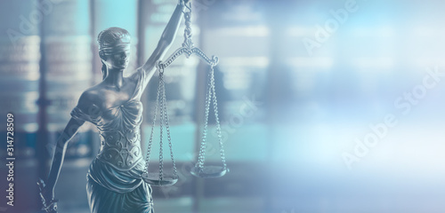 Photo Scales of Justice  legal law books concept imagery