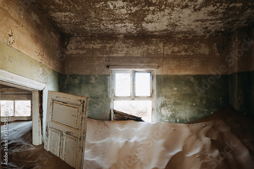 Fotografia, Obraz  desert sand has invaded and taken over these rooms in Kolmanskoppe, Namibia