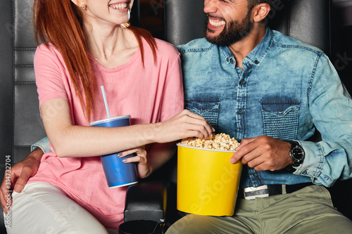 laughing diverse couple spending great time at the cinema, close up cropped photo фототапет