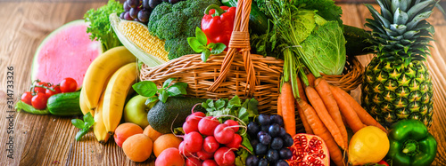 Fototapeta Composition with assorted raw organic fresh vegetables wide banner. Assortment of fruits and vegetable. Healthy raw detox food diet panorama concept. obraz
