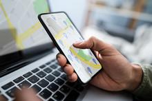 Person Using GPS Navigation Ma...