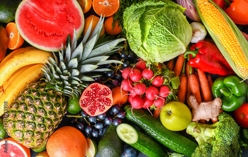 A variety of fresh fruits, healthy vegetables top view. Large vegetable food and citrus mix collection.