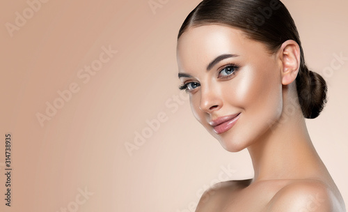 Beautiful young woman with clean fresh skin on face Canvas