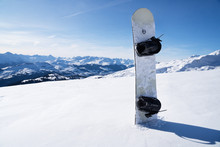 Snowboard Standing In Snow Wit...