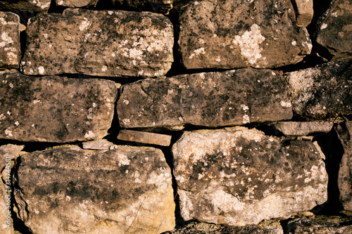 High quality image of old and textured stone wall