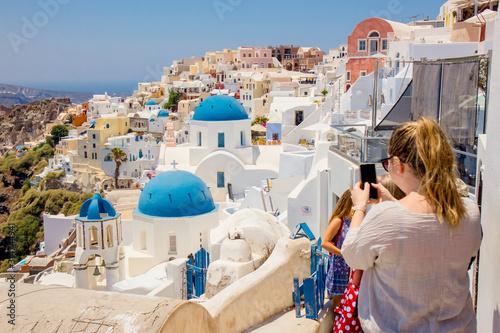 Fototapeta Famous blue dome orthodox church in village of Oia on Santorini island in Greece in Europe.  obraz